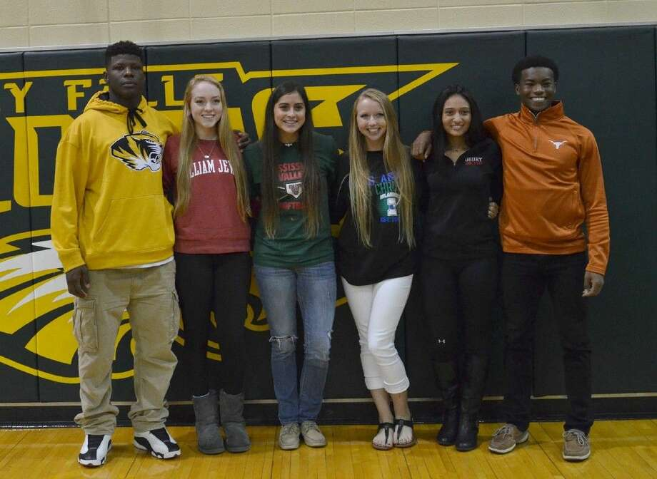 Cypress Falls athletes celebrate signing letters of intent on Nov. 11. Pictured (L-R) are Trey Baldwin, football, Missouri; Lauren Castaneda, volleyball, William Jewel; Elissa Salinas, softball, Mississippi Valley State; Lexi Shaw, softball, Texas A&M - Corpus Christi; Dominique Salinas, softball, Drury; and Isaiah Lucas, track and field, Texas. (Photo by Kristen Camp, Cypress Falls HS)