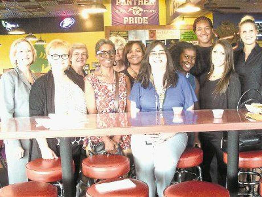 Elkins High School teachers and staff gather for a teacher appreciation soiree courtesy of Fuzzy's Taco Shop, Missouri City, and FCIC Consulting.