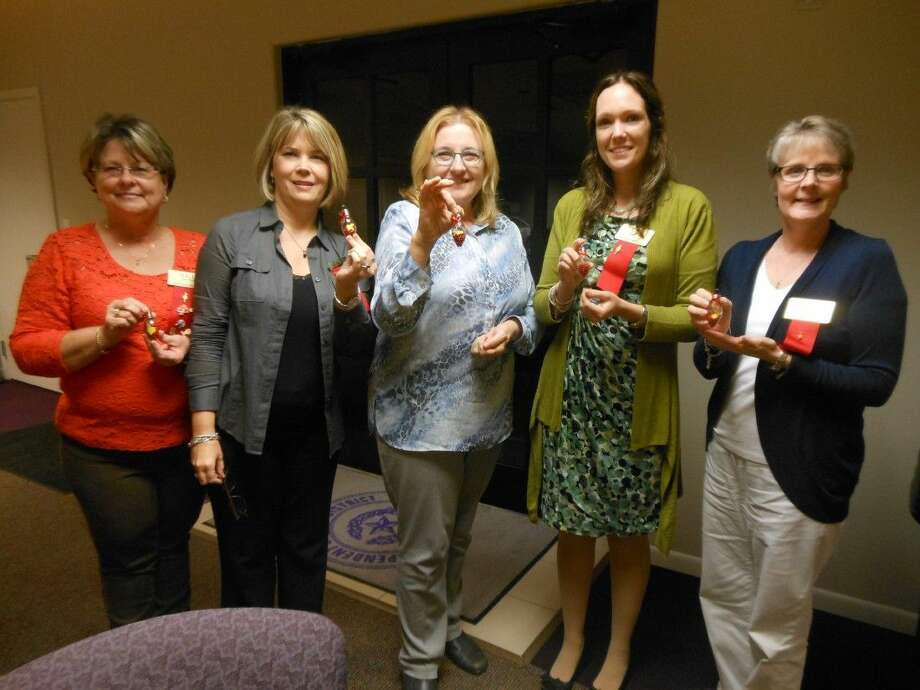 Mu Iota members Cynthia Miller, Amy Ripkowski, Paula Fielder, Toni Wadzeck and Penny Vaulkner show off Christmas ornaments. Photo: Submitted