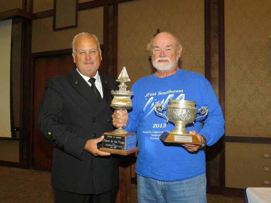 Lakewood Yacht Club Fleet Captain Ashley Walker (left) presented the 'Yacht of the Year' award to racer Bee Bednar for his J/105 named 'Stinger' at the club's Annual Membership Meeting held on Saturday, Nov. 14 in the ballroom.