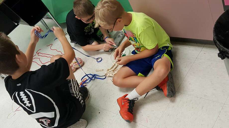 """A team of campers use critical thinking and problem solving skills to help make and """"Epic Park"""" during Camp Invention at Huffman Intermediate School the week of Monday, June 20."""