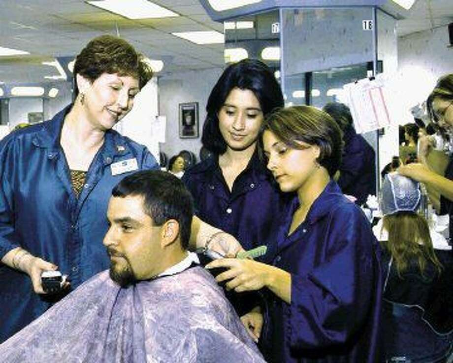 Cosmetology professor Bliss Mayberry instructs cosmetology students on various skills and techniques in Lone Star College-Kingwood's salon.