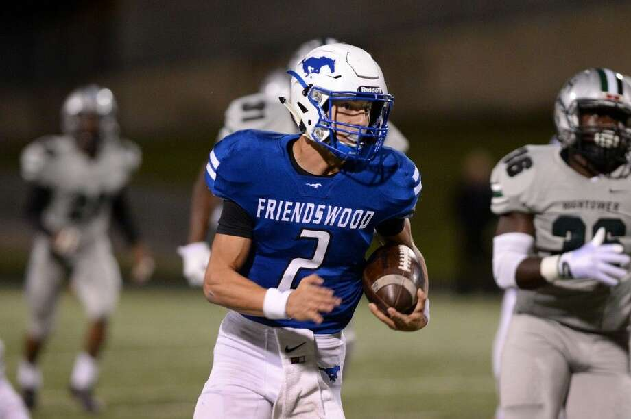 Friendswood's Tyler Page runs for sizeable yardage against Fort Bend Hightower Thursday night in Missouri City. The Mustangs upset the Hurricanes, 27-24. Photo: CRAIG MOSELEY
