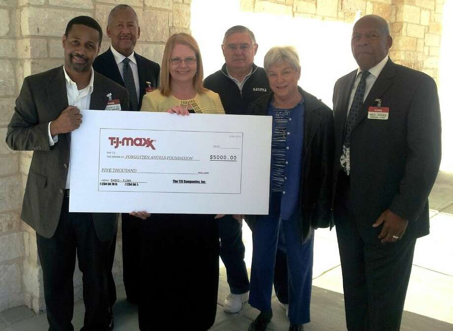 Pictured, left to right, are Store Manager Donald Gaines, District Manager Bennie Dixon, Forgotten Angels Development Director Holly McDonald, Forgotten Angels family members Ron and Jacque Attra and T.J. Maxx Regional Vice President Ned Jones.