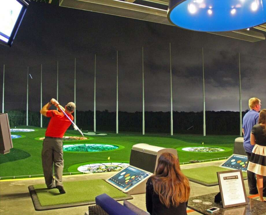 Topgolf recently opened its doors at 21401 Gulf Freeway and features more than 100 climate-controlled hitting bays that can host as many as six players at a time. The new 65,000 square foot entertainment venue is expected to attract 450,000 visitors annually. Photo: Kristi Nix