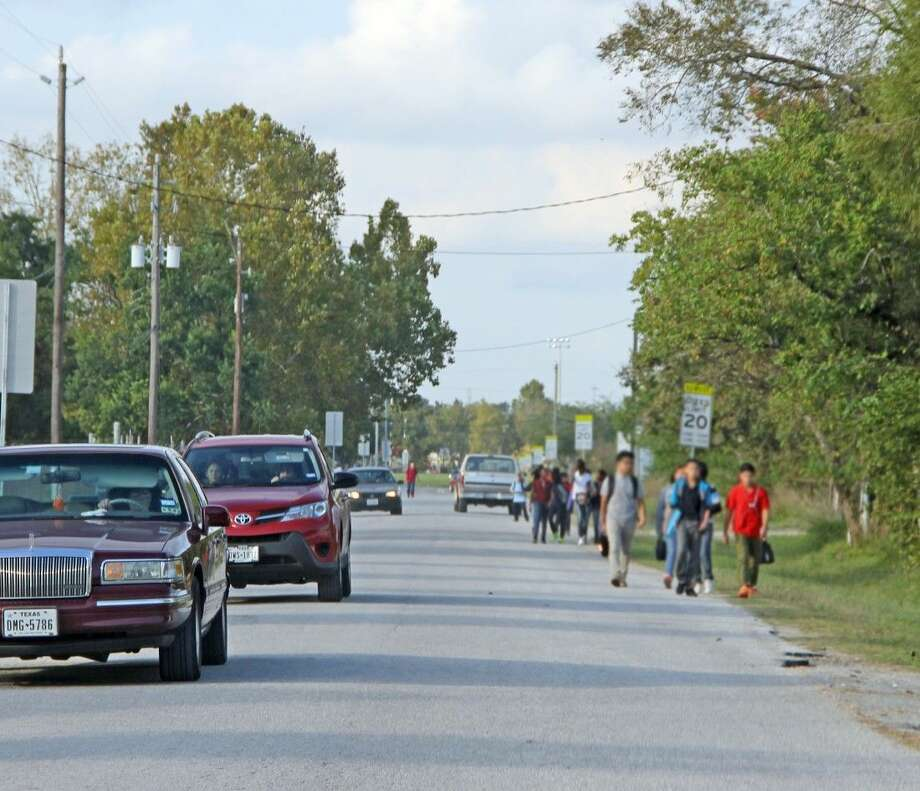 Pasadena students walking home from Keller Middle School along Magnolia share the road with cars and trucks as there isn't a sidewalk. Safety concerns were recently raised by a group of students who went to the school to ask city officials for their help. Photo: Kristi Nix