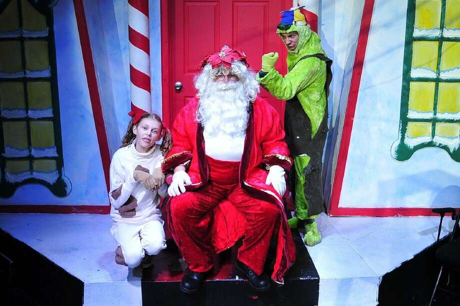 "From left, McKenzie Ivins as Max (guest artist from Deer Park), Jordan West (from Pearland) as Santa, and Dominique Hernandez (from Baytown) as the Young Grinch rehearse a scene from San Jacinto College's production of ""Santa's Christmas Magic, the Musical."" Photo credit: Rob Vanya, San Jacinto College marketing, public relations, and government affairs department."