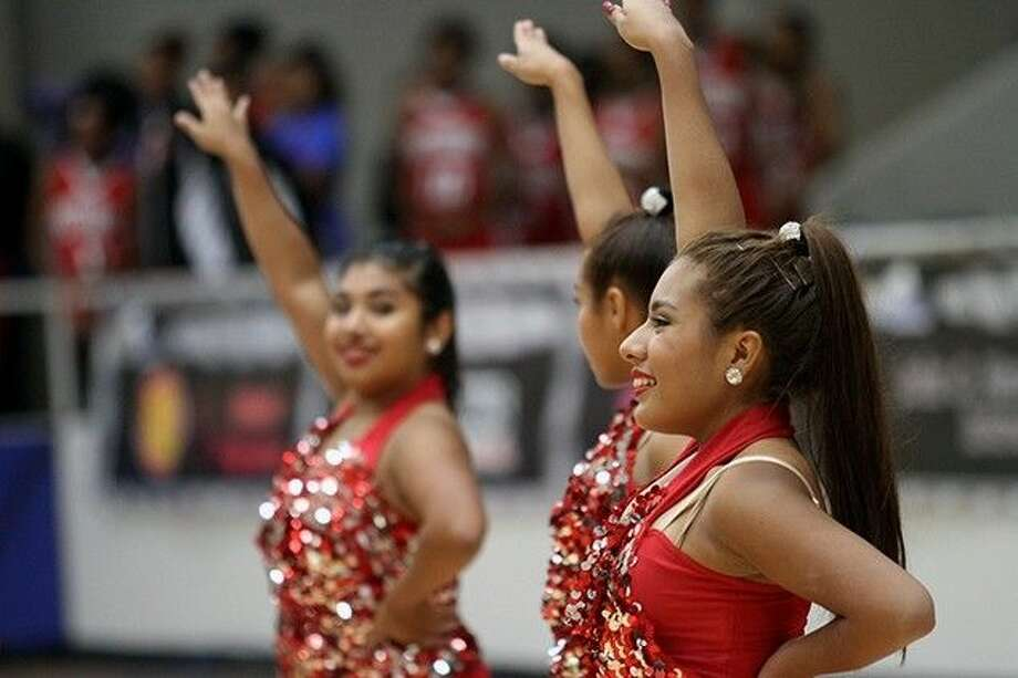 The Pasadena Memorial High School Dance team puts on a dazzling show for audience members at the McDonald's Texas Invitational.
