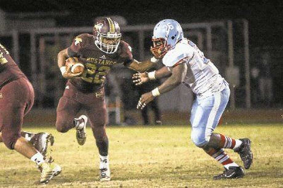 Magnolia West's Adrian Thomas (22) runs the ball Friday at Magnolia West High School. Photo: Michael Minasi
