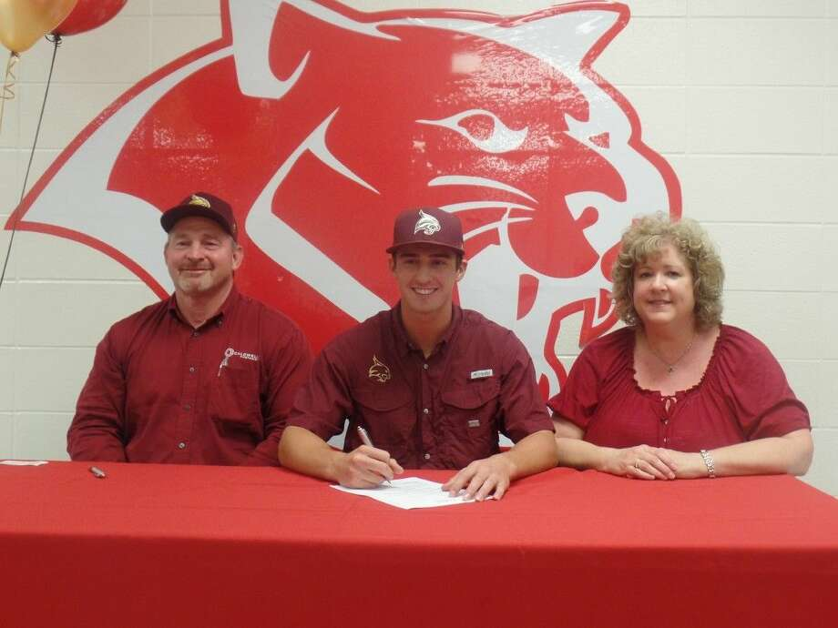 Tomball pitcher Shane Daughety signs his National Letter of Intent to play baseball at Texas State with his parents by his side. Photo: Cameron Brock