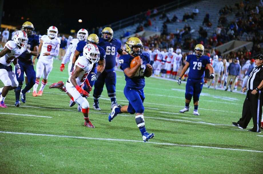 Klein Collins senior running back Justin Pratt rushes 20 yards for a touchdown, one of four he scored against Atascocita at Klein Memorial Stadium Friday, November 13. Photo: Photographer