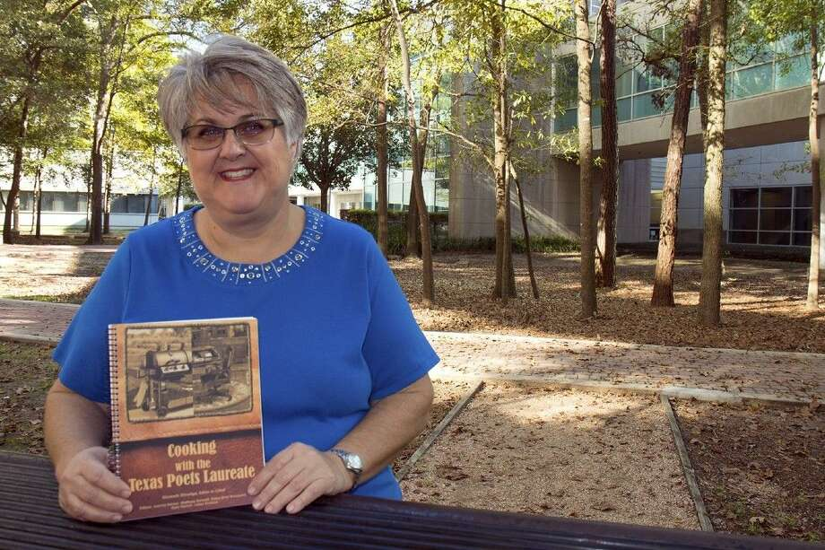 "Lone Star College-University Park instructor Elizabeth Ethredge shows off the cookbook she edited that features recipes from Texas Poets Laureate. ""Cooking with the Texas Poets Laureate"" will be sold to benefit student scholarships during a special reading by 2012 Poet Laureate Jan Seale from 1:30 to 2:30 p.m. on Thursday, Nov. 19, at LSC-University Park, 20515 SH 249 (SH 249 and Louetta Road). Photo: Jen Sansbury"