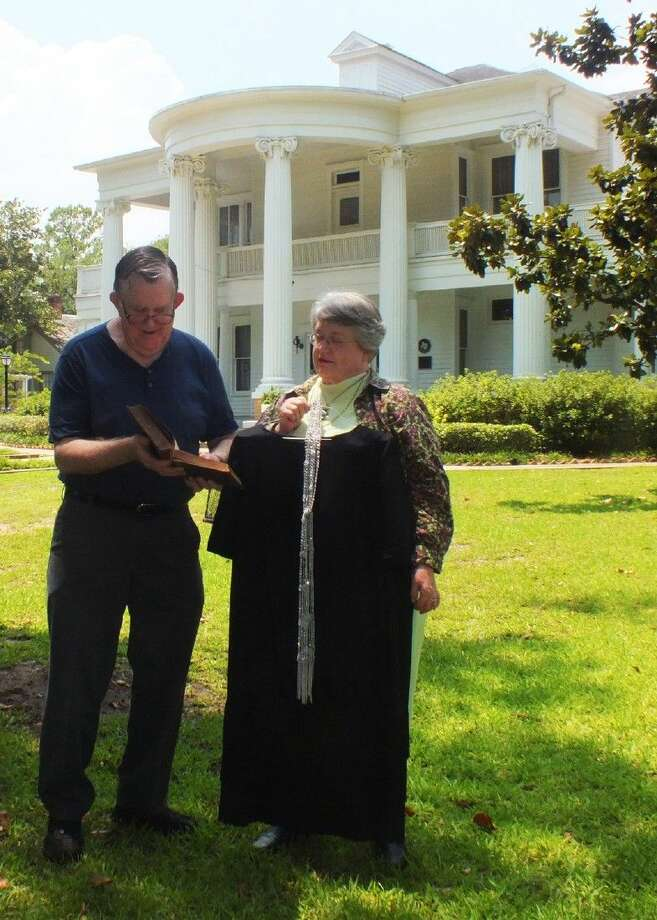 Docent Sally Yates and her husband Dr. Charles Yates, Jr. prepare for the Candlelight Tours as they look over the 1920 medical books of his grandfather, Dr. John S. Yates. Dr. John S. Yates helped to establish the first hospital in Fort Bend County.