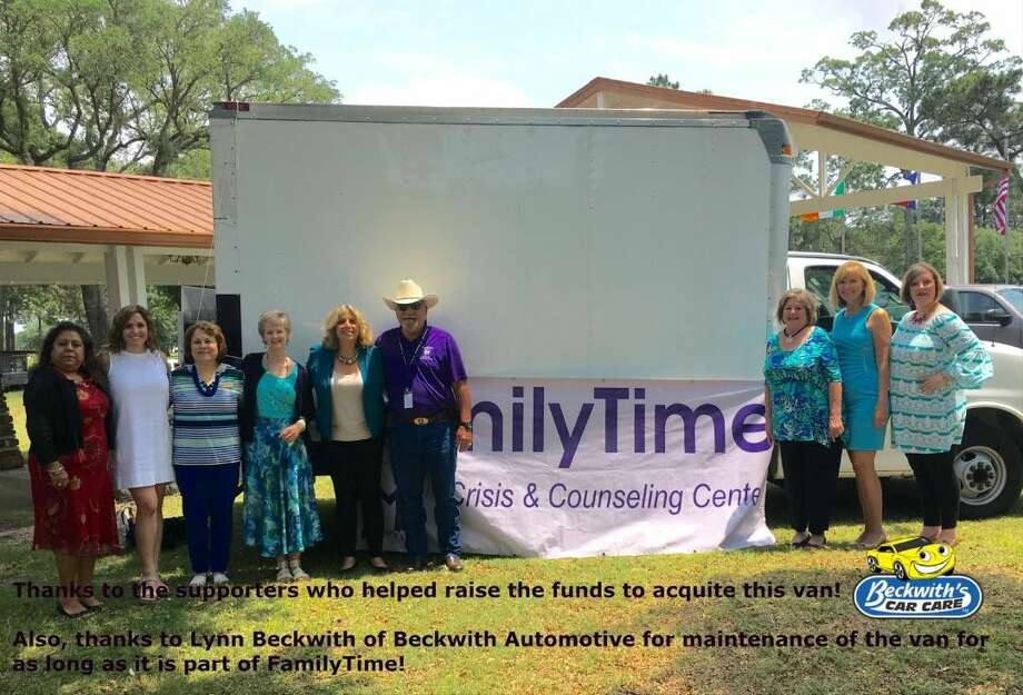 FamilyTime Board Members and staff with the new Truck at the Purple Ribbon Luncheon.