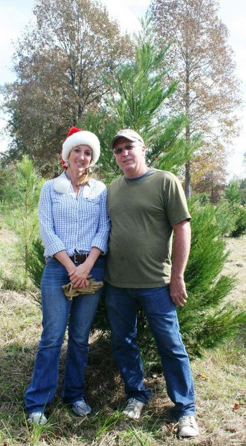 Karen and David Barfield, owners of Tinsel Town Christmas Tree Farm in New Caney, strive to provide an atmosphere of holiday cheer while guests pick out Christmas trees. Photo: Stephanie Buckner
