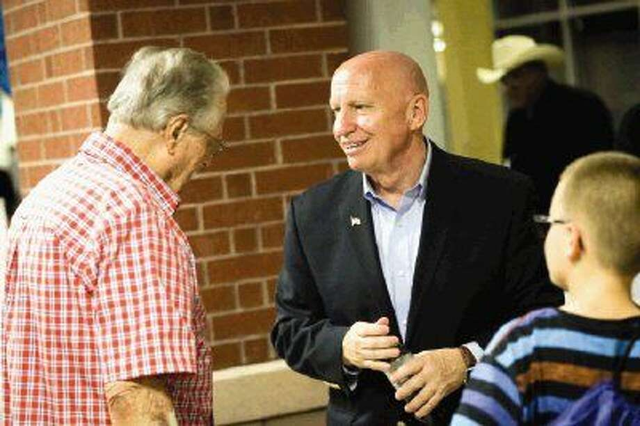 U.S. Rep. Kevin Brady, R-The Woodlands, chats with veterans and their families during the Veterans Day resource fair Wednesday. Photo: Michael Minasi