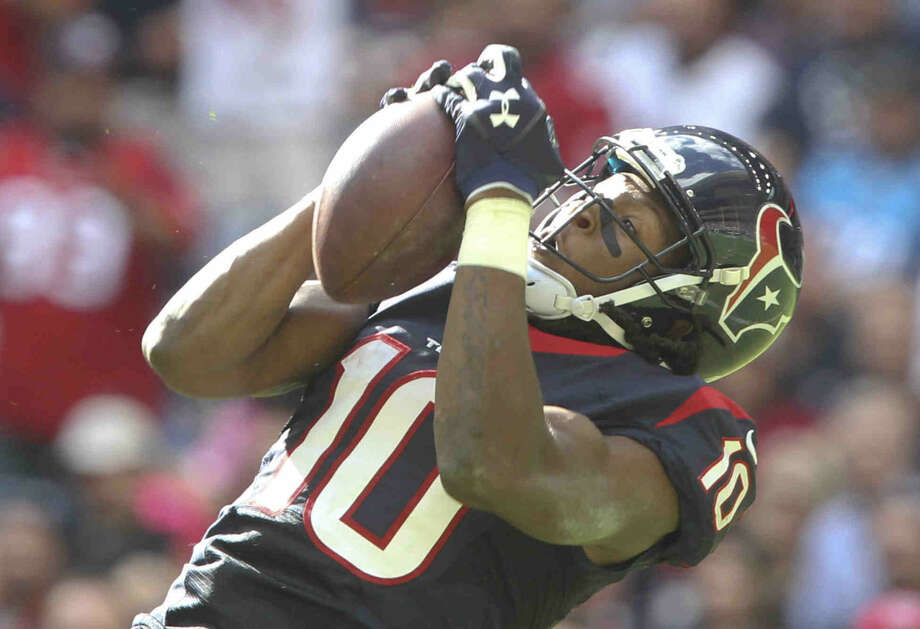 Houston Texans wide receiver DeAndre Hopkins (10) catches a 58-yard touchdown pass in the second quarter of an NFL football game at NRG Stadium Sunday. Photo: Jason Fochtman