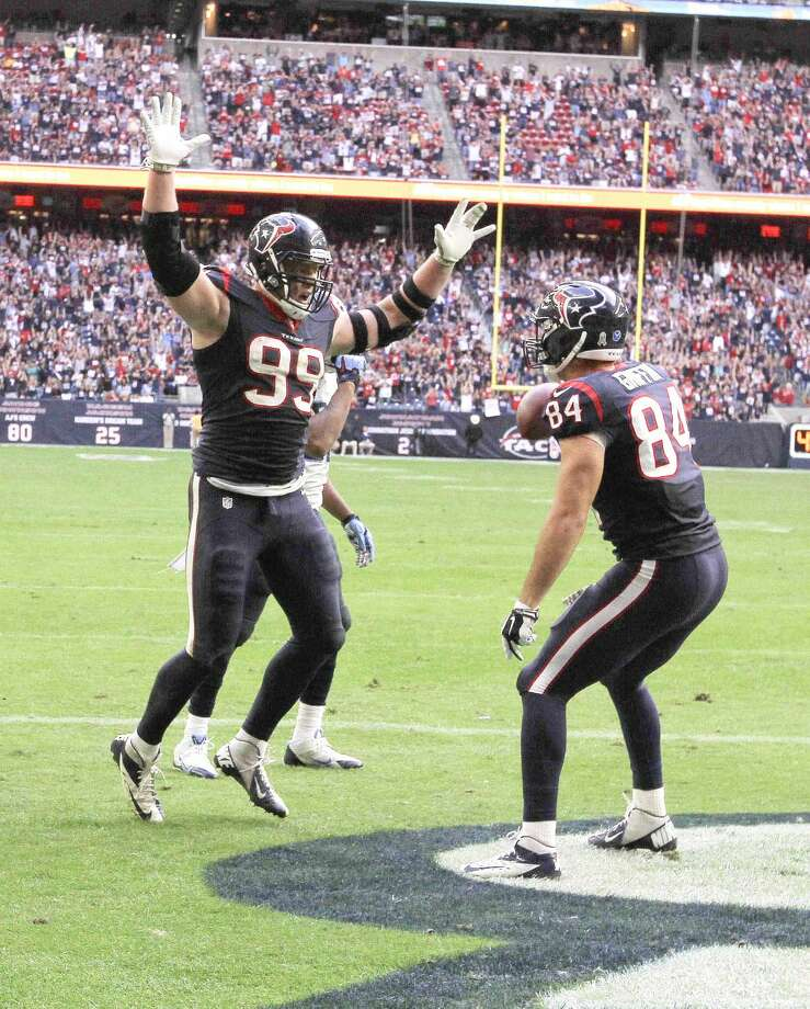 Houston Texans defensive end J.J. Watt (99) celebrates with tight end Ryan Griffin (84) after scoring a touchdown in the fourth quarter of an NFL football game at NRG Stadium Sunday. Watt scored his fifth touchdown of the season after 1-yard touchdown pass from quarterback Ryan Fitzpatrick. Photo: Jason Fochtman