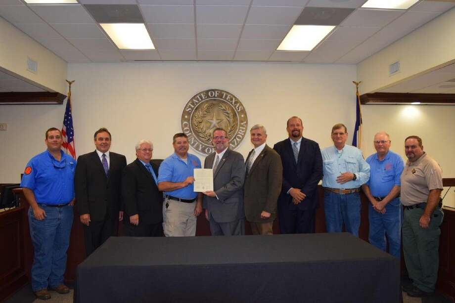 Tim Morrison was presented with a Resolution of Appreciation during Commissioners' Court for support of the Gulf Coast Emergency Rescue Squad during recent flooding events in Brazoria County. Pictured are Will Blackstock, Commissioner David Linder, Pct.4; Commissioner Stacy Adams, Pct. 3; Tim Morrison; County Judge Matt Sebesta, Commissioner Dude Payne, Pct. 1; Commissioner Ryan Cade, Pct. 2; John Blankenship; Jim Blankenship and David Thacker.