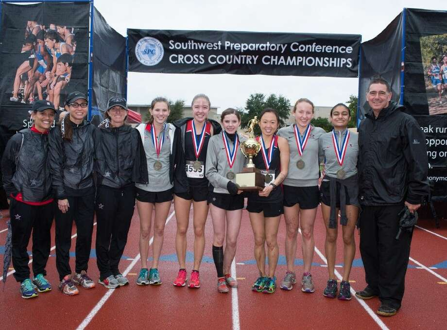 The St. John's girls cross country team holds its Southwest Preparatory Conference championship trophy after the Mavericks recently won the SPC meet in Austin. The girls had five of the top six runners to finish the race and dominated the competition, needing only 20 points to get the championship. (David Shutts / DavidShuttsPhotography.com) Photo: 2015 SPC Cross-Country