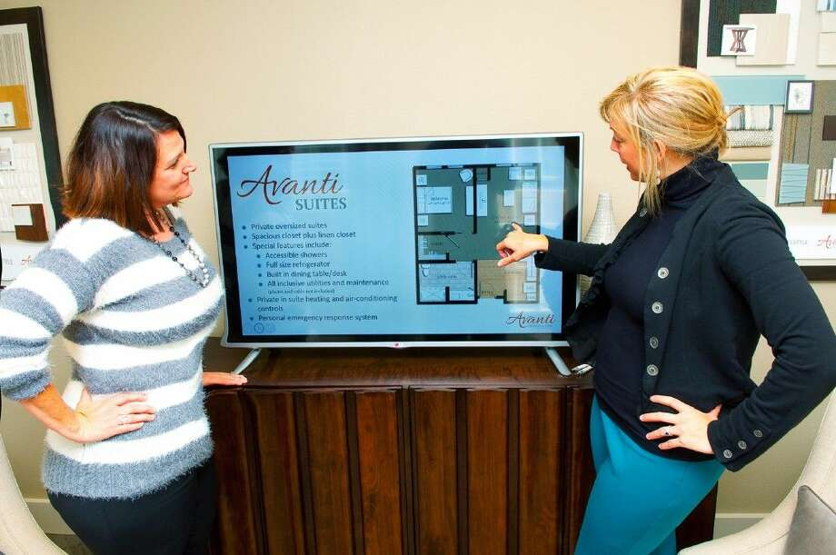 Jan Kaiser (left) and Shawna Dodd (right) of Avanti conduct a presentation showing the floor plan for the new Avanti at Towne Lake center for assisted senior living.
