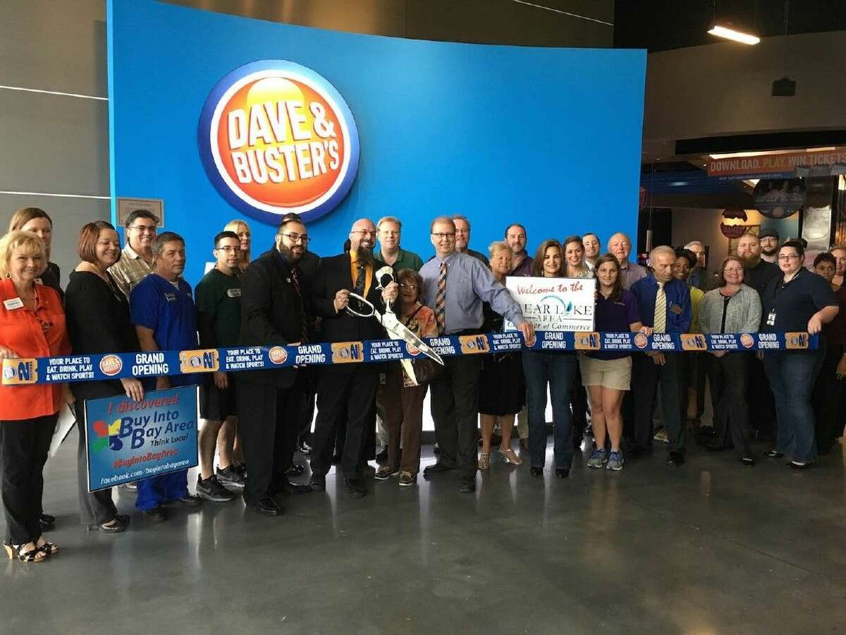 Cutting the ribbon at Dave & Buster's.