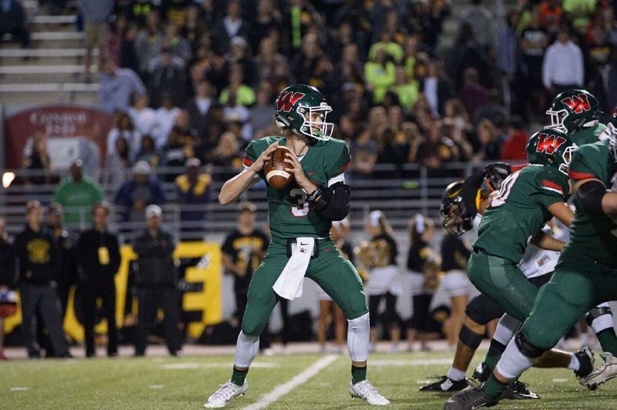 The Woodlands' Eric Schmid looks to pass against Klein Oak on Friday.