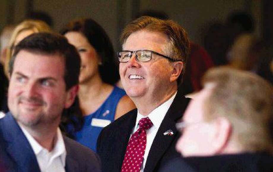 """Texas Lt. Governor Dan Patrick, center, with state Sen. Brandon Creighton, R-Conroe, will be presiding this week when the so-called """"sanctuary cities"""" bill comes up for debate in the Senate. Photo: Jason Fochtman"""
