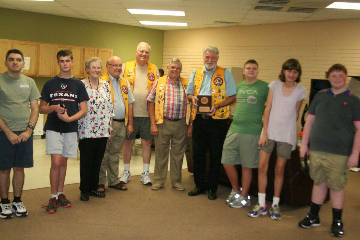 The Humble Noon Lions Club posed with a few of the Including Kids clients.