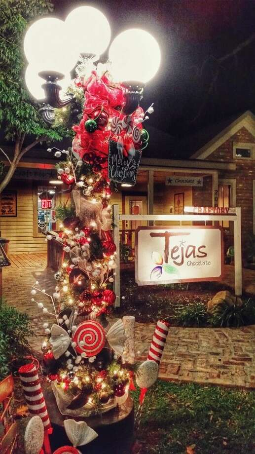 dozens of ornamental lamp posts throughout downtown tomball have been decorated for the christmas season by
