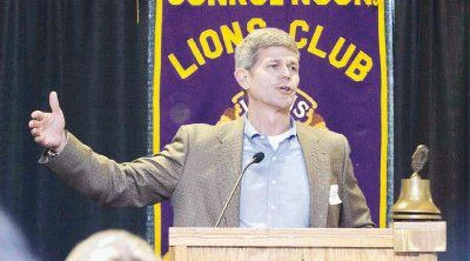 College Park coach Clifton McNeely talks about his team during the Conroe Noon Lions Club's 39th Annual Roundball Roundup on Wednesday.