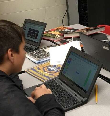 Spring ISD is increasing the number of Chromebooks available in schools and making other technology upgrades, district officials said in fall 2017. In this file photo, eighth graders in the neighboring Splendora school district use Chromebooks from a cart to complete a social studies assignment.