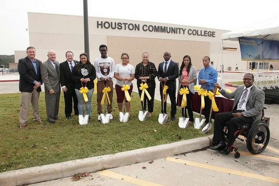 HCC students pose with Zeph Capo, HCC Trustee District I, Dave Wilson, HCC Trustee, District II, Robert Glaser, HCC Trustee, District V and Dr. Fena Garza, HCC Southwest president for groundbreaking of new garage at West Loop Campus.