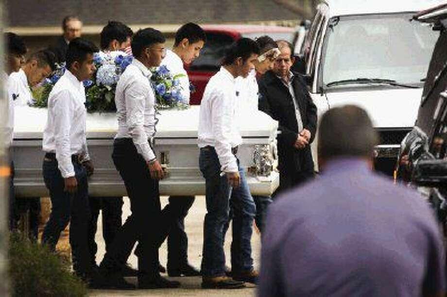Pallbearers escort the casket of 11-year-old Adan Hilario Jr., who