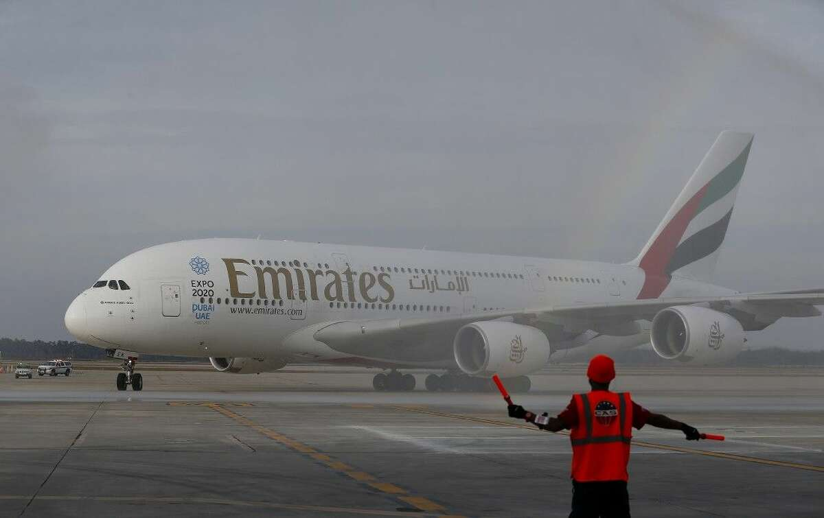 Emirates' inaugural A380 flight to George Bush Intercontinental Airport touches down on Wednesday, Dec. 3, 2014, in Houston.