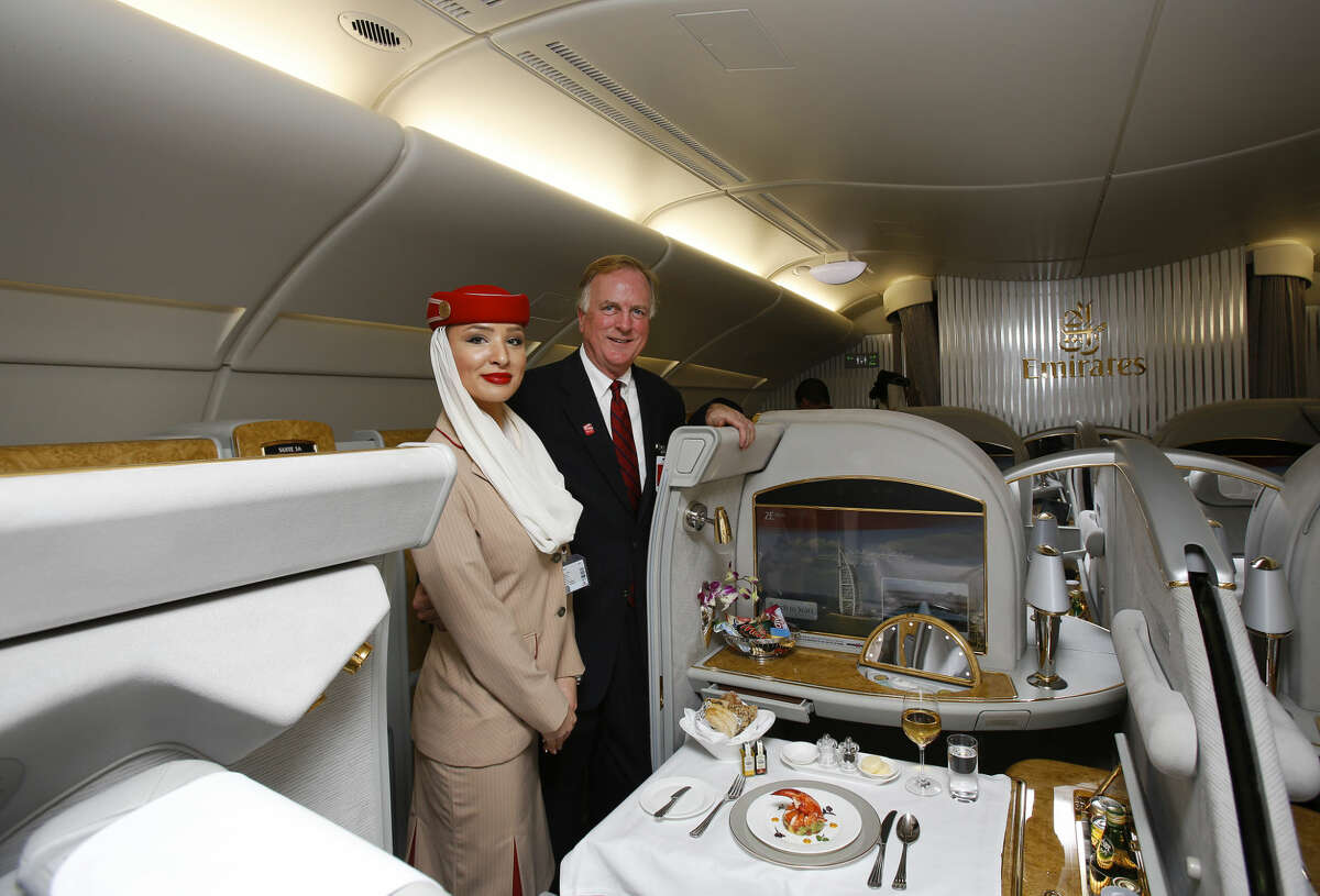 Emirates Regional Sales Director Central USA, Alexander Houston, right, tours the A380 with an Emirates' cabin crew at George Bush Intercontinental Airport on Wednesday, Dec. 3, 2014, in Houston. (Aaron M. Sprecher/AP Images for Emirates)