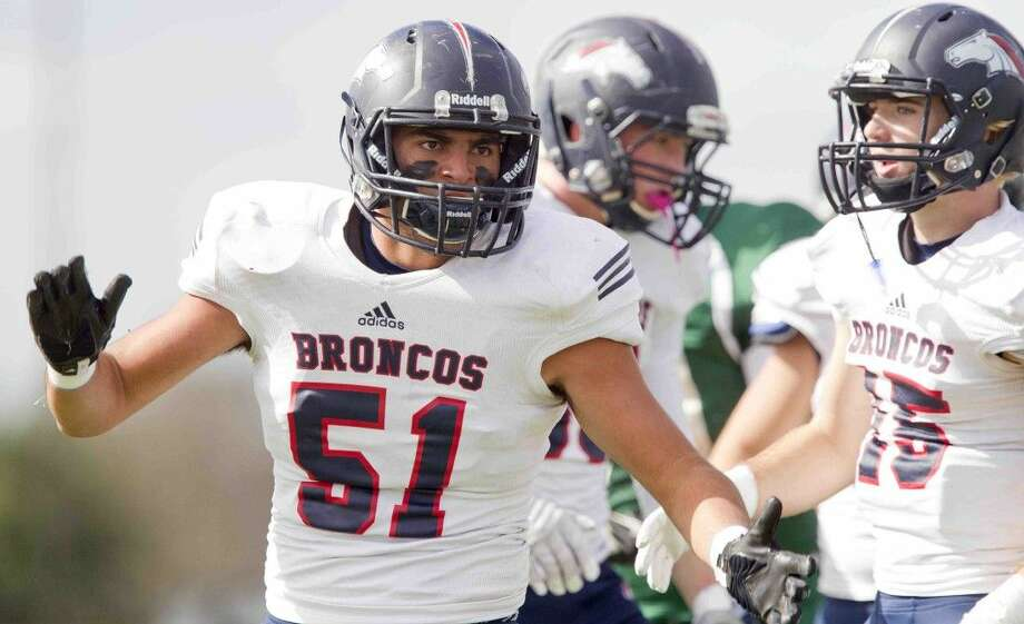 Bay Area Christian linebacker Dante Rivera (51) and teammates will try to slow down a potent Cedar Hill Trinity Christian offense on Saturday. Photo: JASON FOCHTMAN