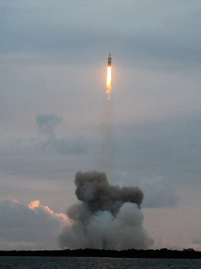 Orion and the Delta IV Heavy Rockets lift off.