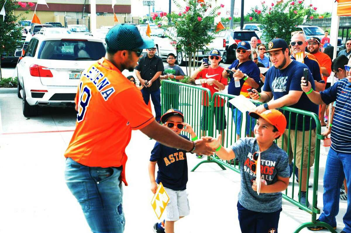 Julio Struve, a young Astros fan from the Cypress area, shakes hands with Astros third baseman Luis Valbuena at the June 21, 2016 Whataburger Whatafan event. Struve, who had previously only encountered Valbuena out at the ballpark, was thrilled to meet one of his favorite Astros players in his home town.