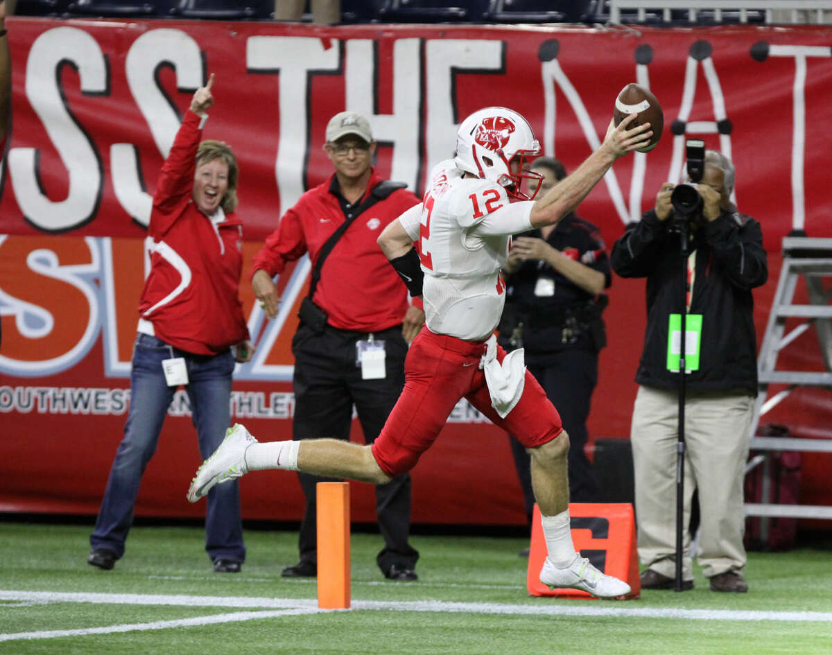 Katy's quarterback Garrett Doiron runs for a touchdown during the Class 6A Division II Region 3 playoff Dec. 5 at NRG Stadium in Houston. The Tigers won 45-17 to advance to their third consecutive state semifinal.