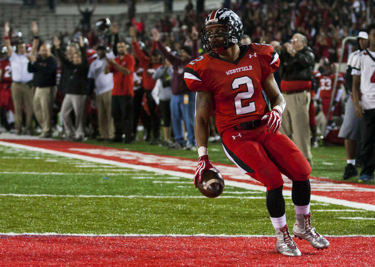Westfield running back Latevius Downs (2) scores the first touchdown of the game early in the first quarter of the Class 6A Division II, Region II, playoff football game, Saturday, December 6, 2014, at TDECU Stadium in Houston.