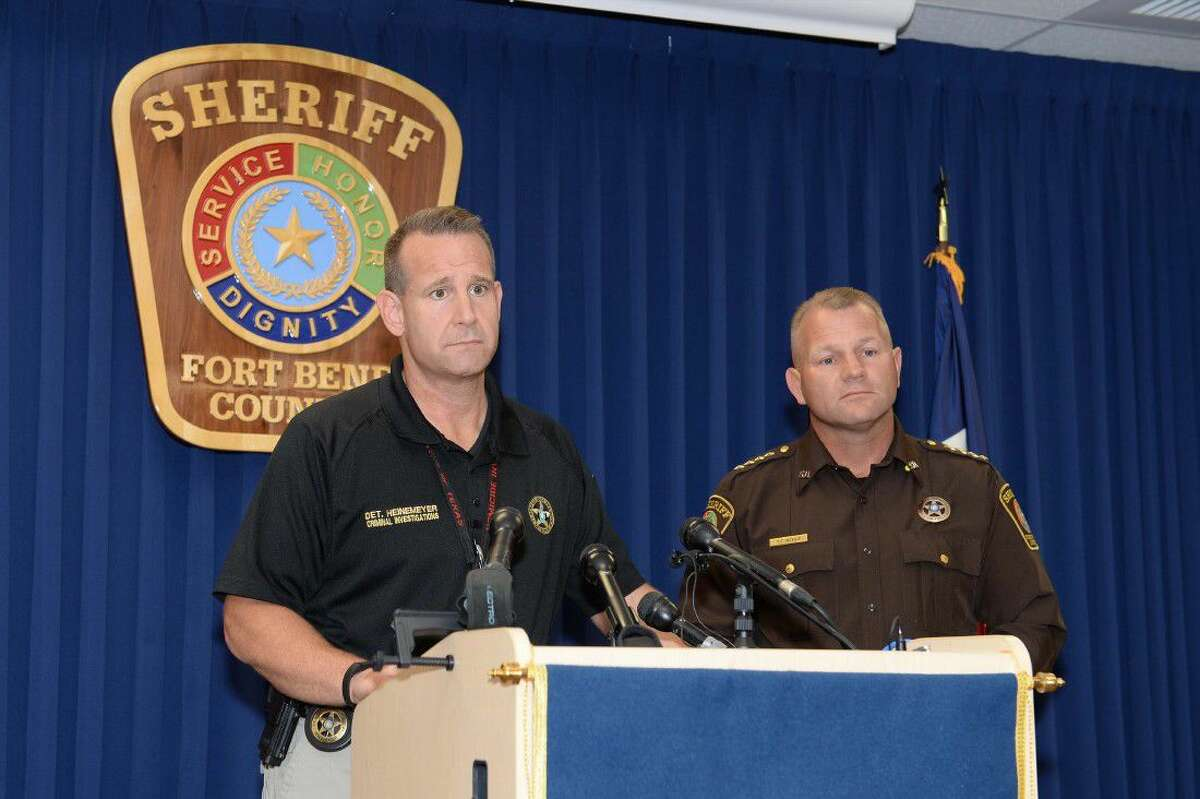 Fort Bend County Sheriff's Office Lead Detective Heinemeyer, flanked by Sheriff Troy Nehls, answers questions for the media regarding their interview of Jason Sheats during a press conference June 29.