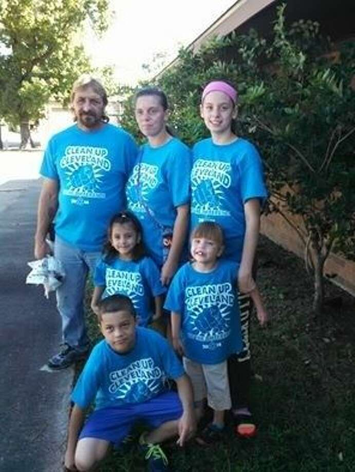 James Broussard stands with his partner and their family during the Clean Up Cleveland event, showing his willingness to sacrifice his own time to help others. Pictured from left to right (top) are James Broussard, Kerri Wilson and MyKenzie Fuchs; (middle) granddaughter Mae Mae Broussard, Haylee Allen; and (bottom) Travis Allen. Photo: Jacob McAdams