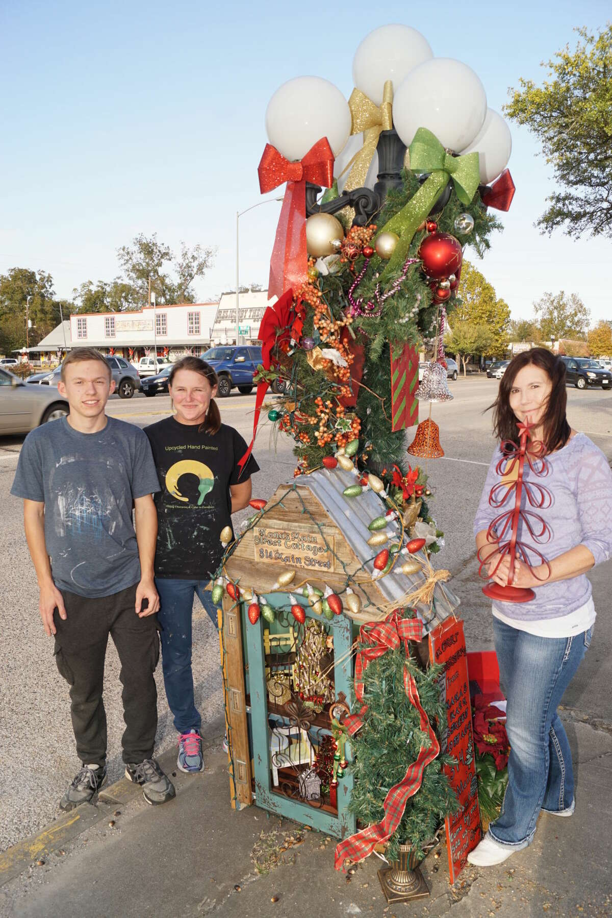 The team from Nana's Main Street Cottage took the best overall award for their creation in Tomball's annual Downtown Holiday Lamp Post Stroll. Shown are, from left, Darryl Romero, Tiffany Romero, and Ann Howes.