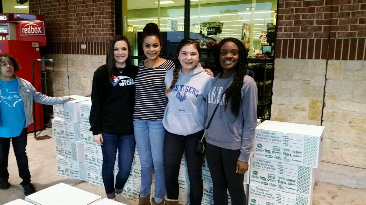 Atascocita High School students and HAAM volunteers Aryana Lyles, Erika Ivy, Mallory Emswiler, and Caelia Marshall prepare to help families receive their free Thanksgiving dinners during the sixth annual Bird Bowl and HAAM food drive at Atascocita's Kroger Tuesday, Nov. 24, 2015.
