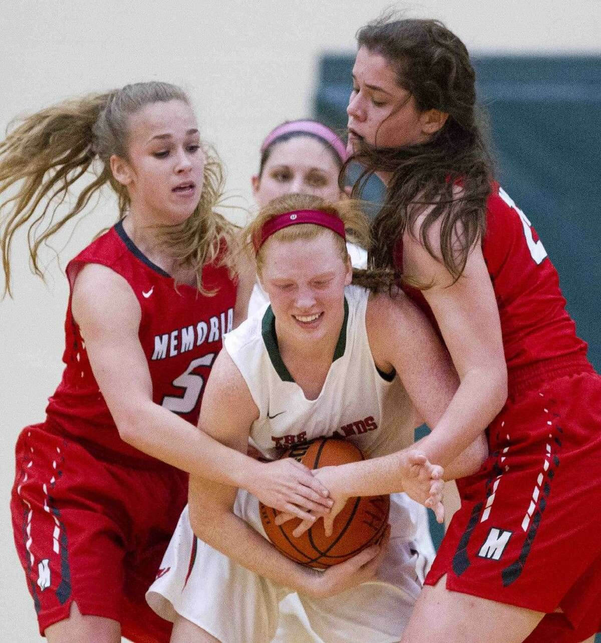 The Woodlands forward Madison Mcgurrin fights Memorial guard Kelsey Slattery and forward Elizabeth Eubank for control of a loose ball during a high school basketball game Tuesday, Nov. 24, 2015, in The Woodlands. Go to HCNpics.com to view more photos of the game.