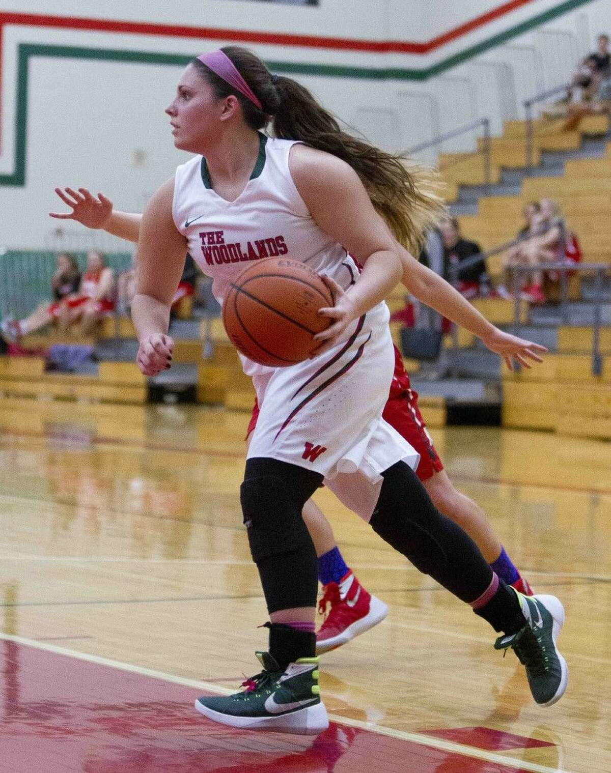 The Woodlands guard Julia Glandt looks to pass Tuesday in The Woodlands.
