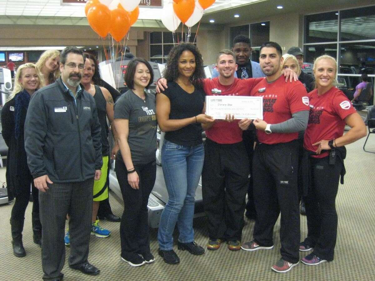 Danielle Gee, center, was recognized and honored for all of her hard work as the winner of the 90-Day Challenge at Life Time Fitness Lake Houston.