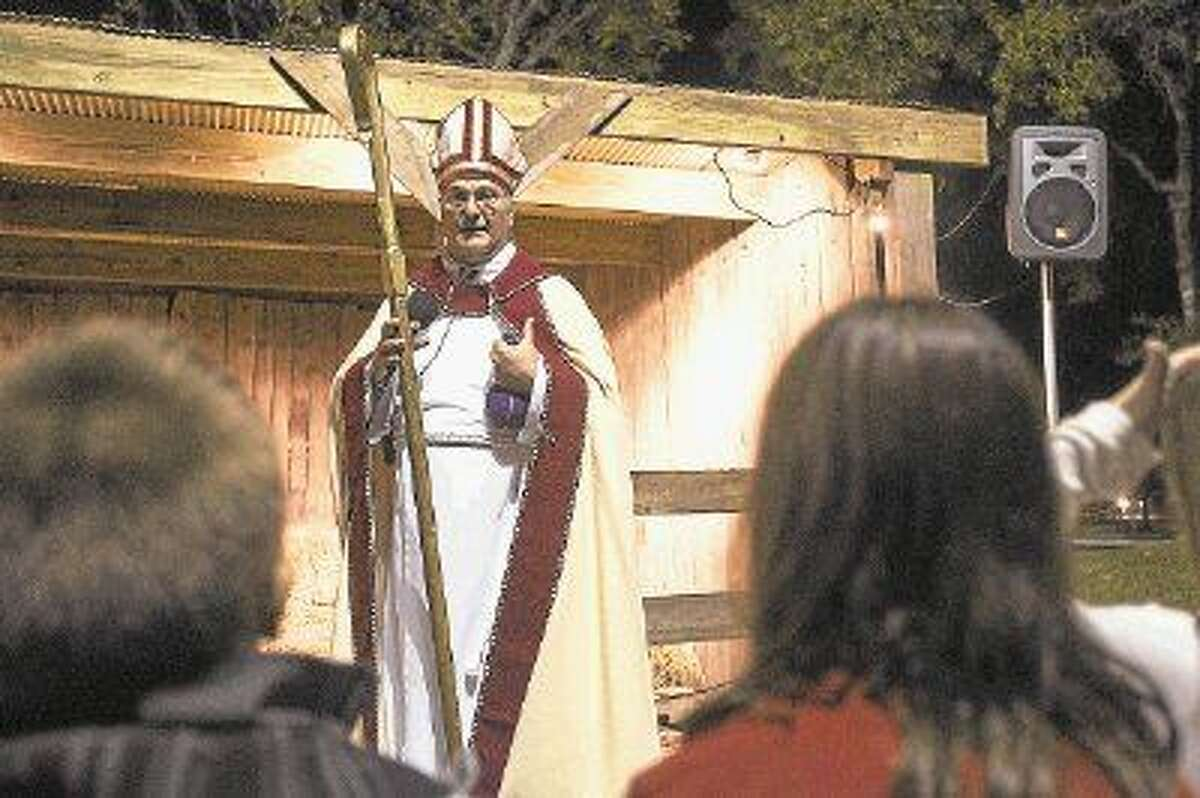 Paul Brinsden explains the history of Saint Nicholas during a Live Nativity performance last year at Good Shepherd Episcopal Church in Kingwood.