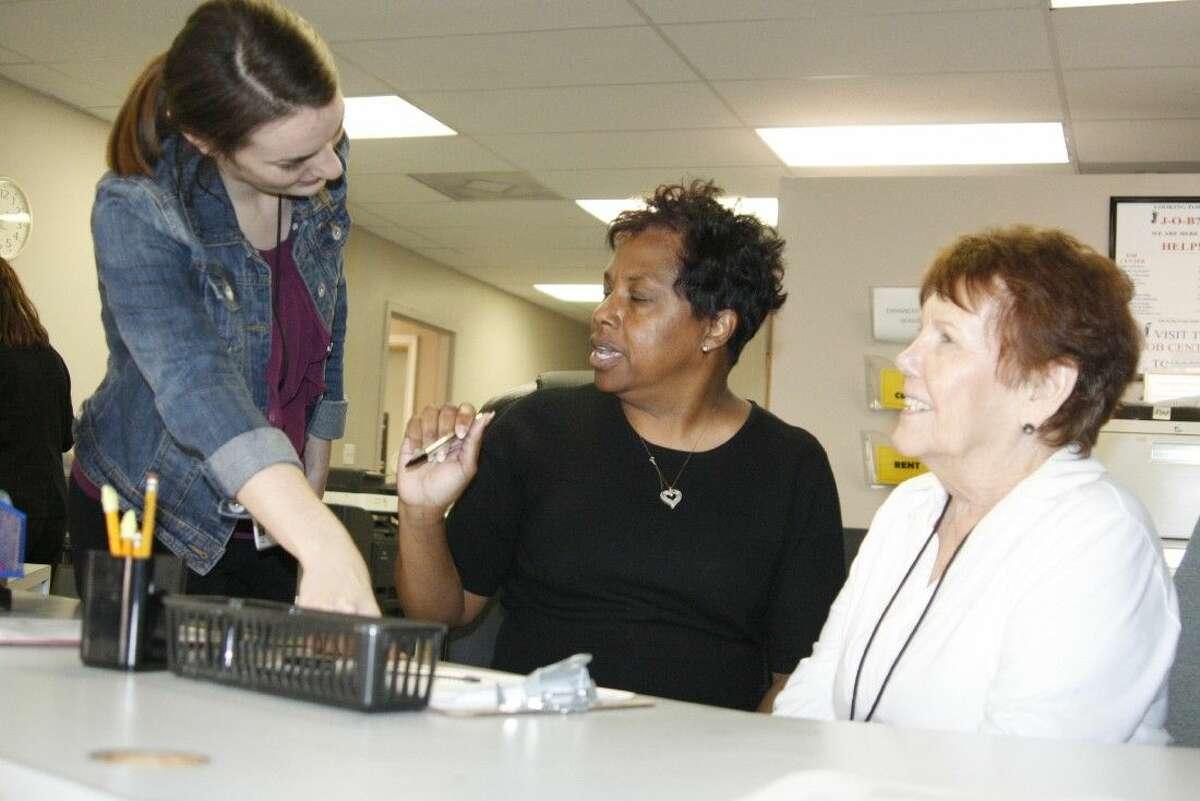 HAAM volunteers help greet new clients.